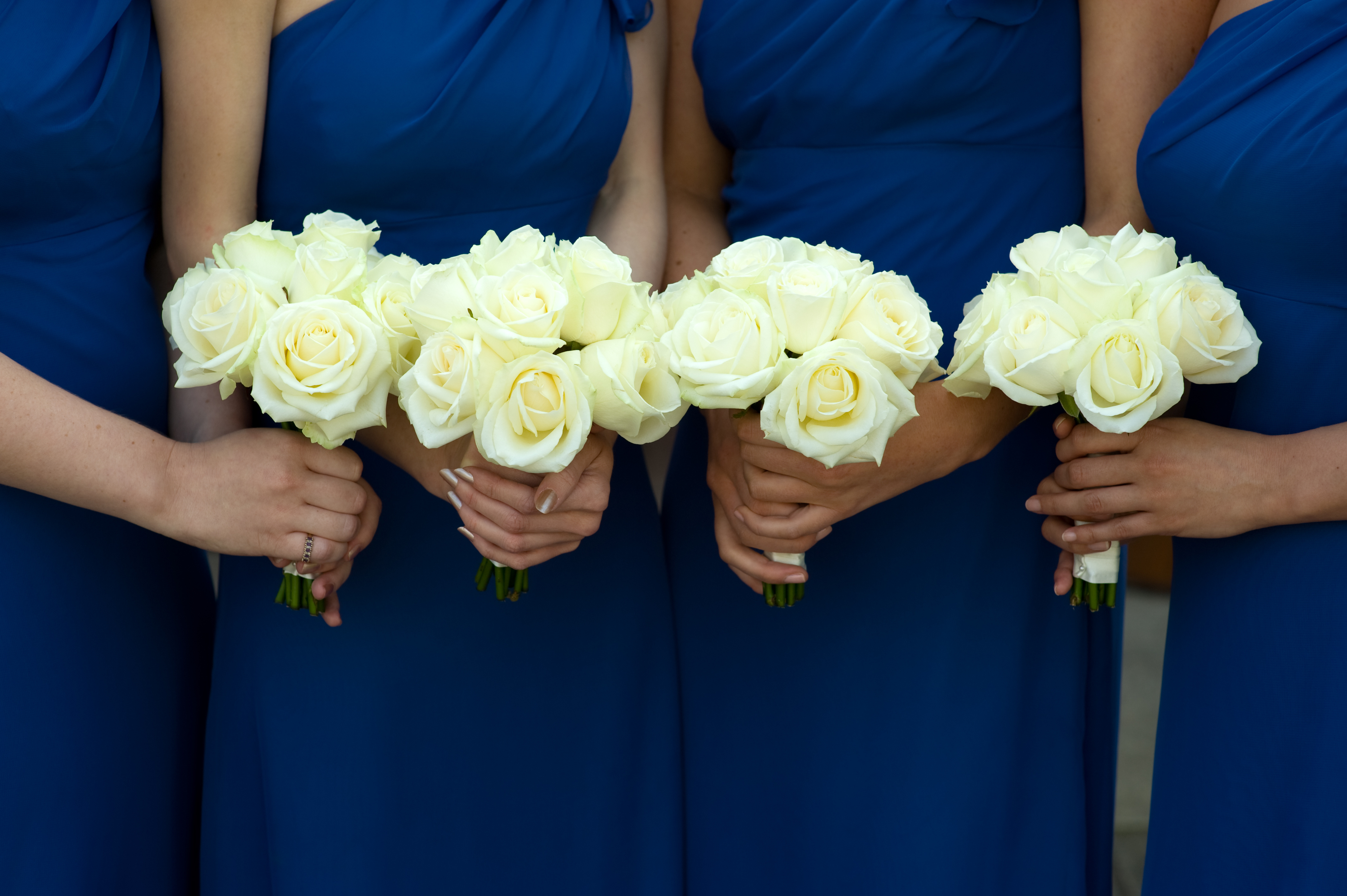 Four Bridesmaids Holding White Rose Wedding Bouquets Susie Roberts